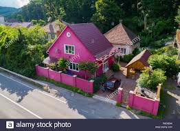 A Nice Pink House With A High Fence And A Wooden Gazebo In The Yard For Your Design Stock Photo Alamy