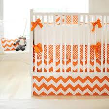 white and orange crib bedding