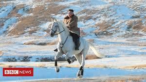 kim jong un n leader rides horse up sacred mountain