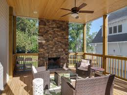 screened porch with natural stone