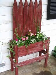 A Little Bit Of This That And Everything Pallet Project Pallet Flower Box Pallet Flower Box Fence Planters Porch Planters