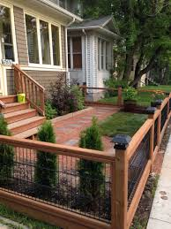 This Sweet Front Yard Is Really Made By The Beautiful Timber Fence With Stone Path In Similar Tones V In 2020 Patio Fence Small Front Yard Landscaping Backyard Fences