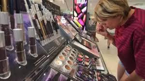 woman testing makeup in macys