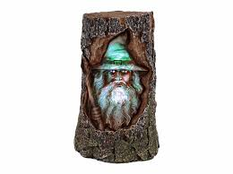 wizard led tree trunk statue garden