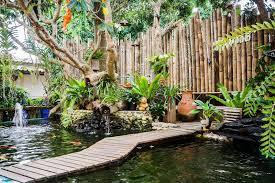 koi fish and decorated bamboo wall