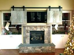flat screen fireplace above fireplace