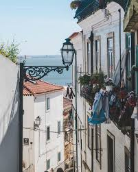 Lisbon is a city of narrow hidden staircases that ferry you up to places  and views you never imagined were possible. It's t… | Travel blogger,  Lisbon, Perfect place