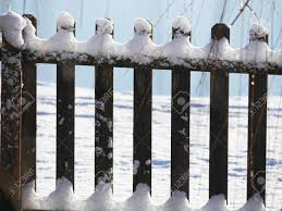 Close Up Of A Wooden Fence With The Tops And Bottoms Covered Stock Photo Picture And Royalty Free Image Image 134949119