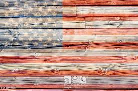 Old Painted American Flag On Dark Wooden Fence Stock Photo Picture And Low Budget Royalty Free Image Pic Esy 039651335 Agefotostock
