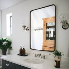 rounded rectangle metal framed mirror