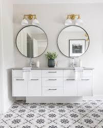 mirrors over white double bath vanity