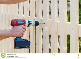 Building A Wooden Fence With A Drill And Screw Close Up Of His Hand And The Tool In A Diy Concept Stock Image Image Of Home Natural 79688275