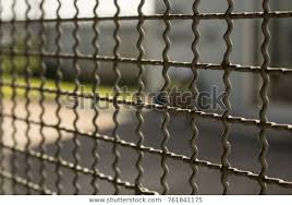 Close Steel Wire Mesh Fence Wall Backgrounds Textures Stock Image 761841175