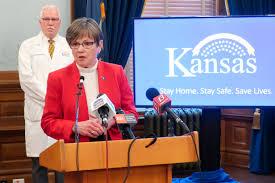 Kansas governor signs order mandating face masks in public