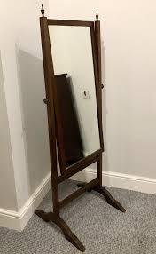 antique mahogany cheval mirror in a