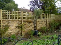 Alternative Fence Idea Combination Brick And Wood To Make A Very Tall Privacy Fence Trellis Fence Backyard Fences Backyard Privacy