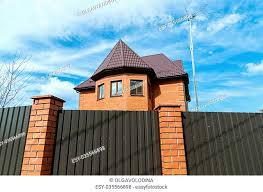Residential House Behind A Fence Stock Photos And Images Agefotostock