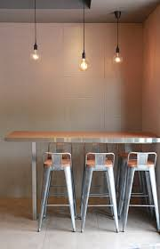 gray tile wall and hanging decor lamps