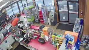 2 teens seen ignoring store clerk who collapses in front of them, stepping  around him to rob register