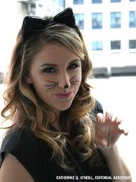 drawing cat whiskers on your face at