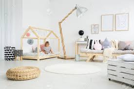 Girl Sitting On Handmade Bed In Cute Scandinavian Style Kid Room Stock Photo Picture And Royalty Free Image Image 87277586