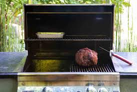 barbecued pork shoulder on a gas grill