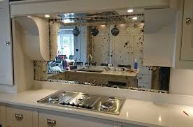 mirror splashback kitchen cabinet