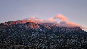 clouds on mountain sandia peak sunset