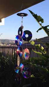recycled cds into sun catcher to keep