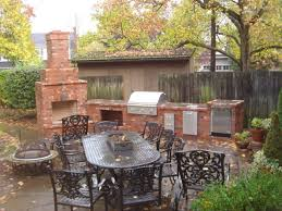 outdoor fireplace with outdoor kitchen