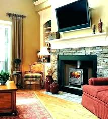 how to hang tv over fireplace