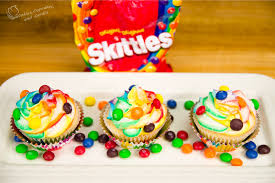 skittles cupcakes with rainbow icing