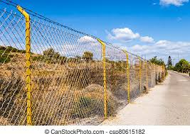 Industrial Wire Fence Panels Metal Fence Panel And Yellow Stakes For A Hill In Crete