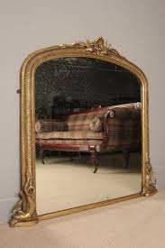19thc dolphin giltwood overmantle mirror