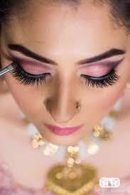 stunning pink and grey eye makeup on a