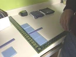 installing a glass tile backsplash in a