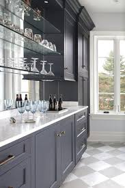 blue bar cabinets with floating glass
