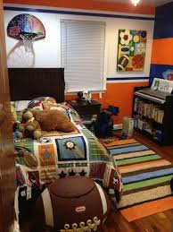 15 Sports Inspired Bedroom Ideas For Boys Sports Themed Bedroom Boy Sports Bedroom Sport Bedroom