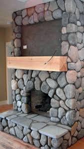 river rock real wood burning fireplace