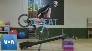 stunt biker turns gym equipment into