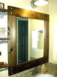 white wood frame bathroom mirror