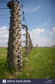 Corner Post Of High Voltage Barbed Wire Electric Fence In Former Stock Photo Alamy