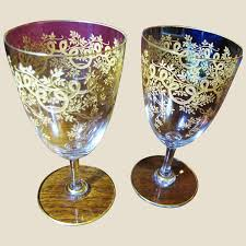 heavily decorated gilt wine glasses