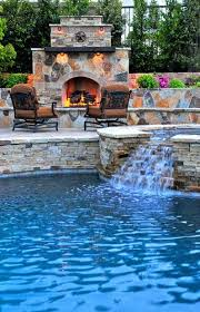 outdoor fireplace with hot tub and