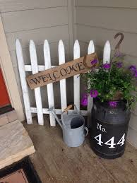 Old Picket Fence Antique Milk Can With Hanging Basket Of Flowers For Front Porch Decor Farmhousesty Spring Porch Decor Front Porch Decorating Diy Front Porch