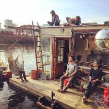 photographer builds his own houseboat