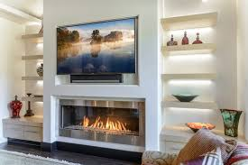 television above fireplace archives