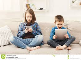 Two Kids With Gadgets On Couch At Home Stock Image Image Of Device Play 109410943