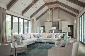 white sectional on blue and silver rug