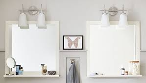 bathroom mirror with an attached shelf